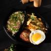 Котлета из свинины с жареным яйцом с жареным картофелем и квашеной капустой Вареники