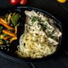 Курица с грибами тушеная в сливочном соусе с домашней лапшой и с салатом из сезонных овощей Вареники