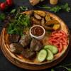 Телятина гриль с картофелем, соусом и овощами Dinapoli