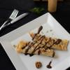 Блины с шоколадно-ореховым кремом и ванильным соусом Dinapoli