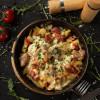 Свинина запеченная с охотничьими колбасками, грибами и овощами Dinapoli