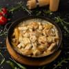 Курица запеченная с грибами и картофелем под соусом Dinapoli